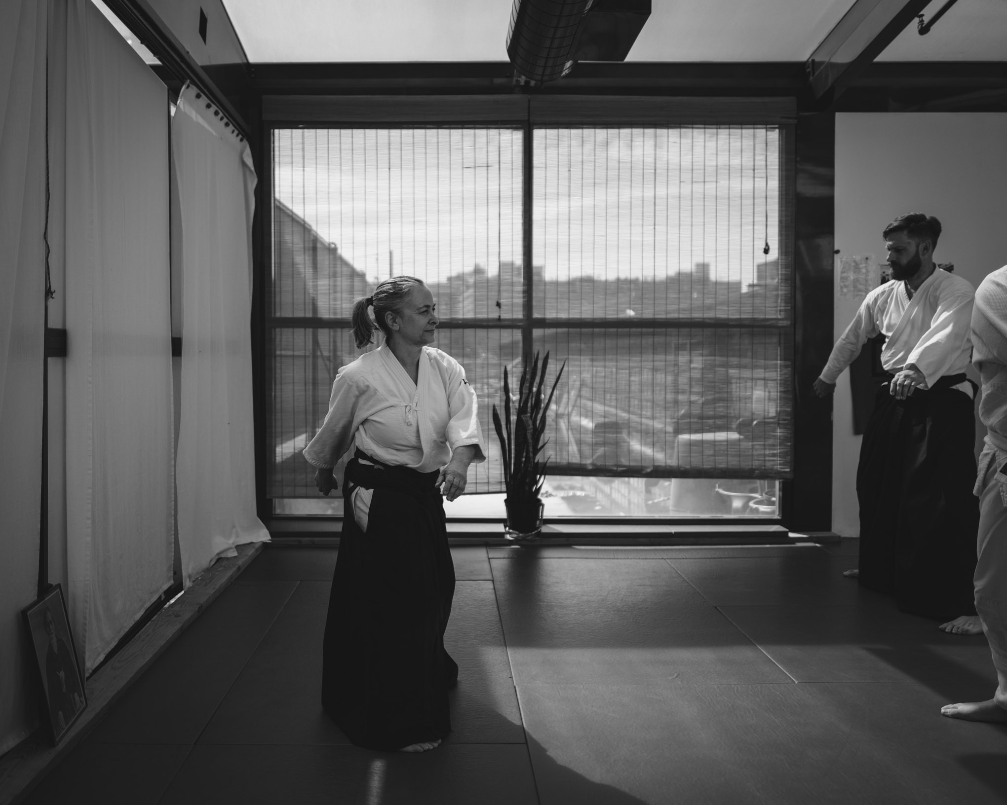Claire Keller warms up at the beginning of an Aikido class at Bushwick Dojo in Brooklyn, New York