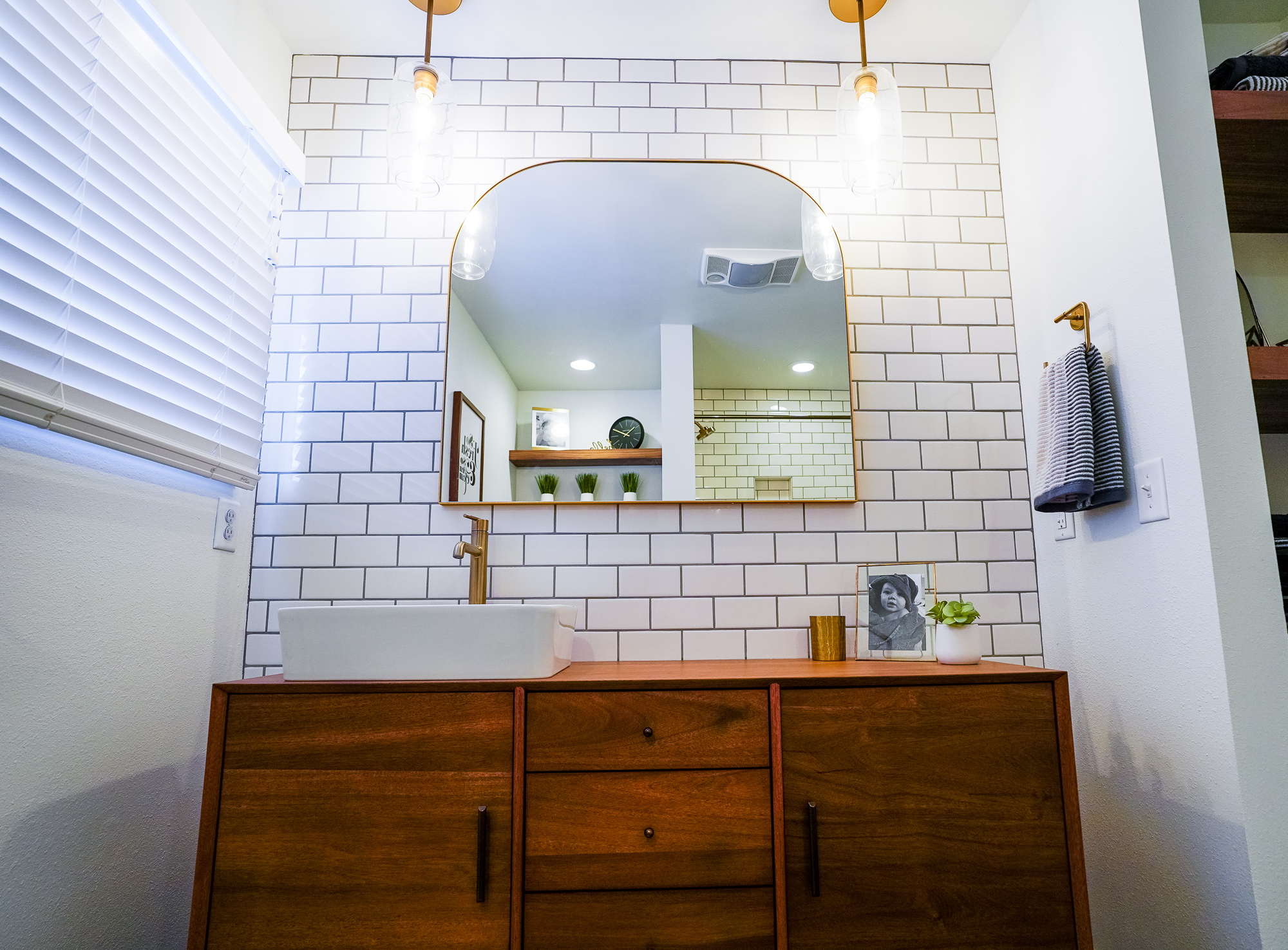 Modern Contemporary - This started as a tiny master bathroom and clunky hallway bathroom. We combined the two into a hallway bathroom perfect for the needs of a family with young kids.