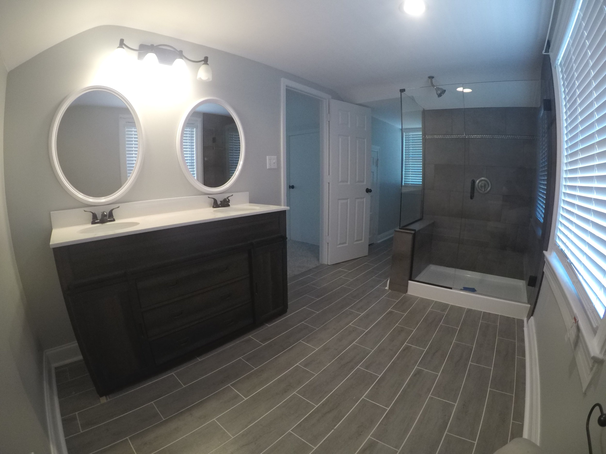 Two 5x8 bathrooms that we gave a little more character to with nice tile floors.