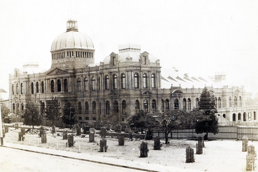Exhibition Building on North Terrace. Piles of rubble and stone suggest the building is still under construction. [On back of photograph] Exhibition Building, North Terrace. Probably 1887. Photographer: Samuel White Sweet. State Library of South Australia. B-3110.
