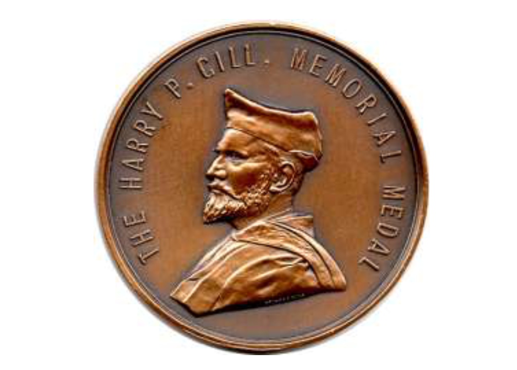Front face of Harry P Gill Medal, South Australian School of Art, University of South Australia. This medal is awarded annually to the student at the South Australian School of Art with the highest grade point average in the field of Design. The medal depicts Harry Pelling Gill in academic dress as an Associate Member of the Royal College of Art (ARCA) London, a position he claimed after 1899.