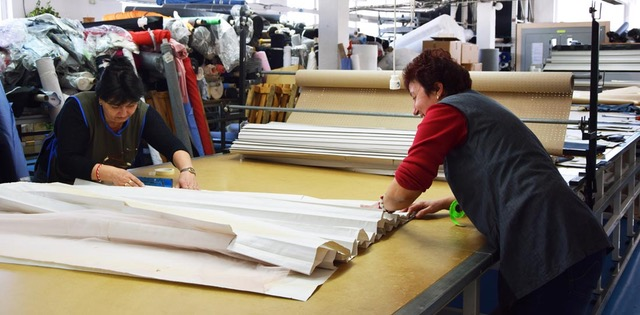 Velichka and Mariela - Preparing the pattern cutting table for some action.