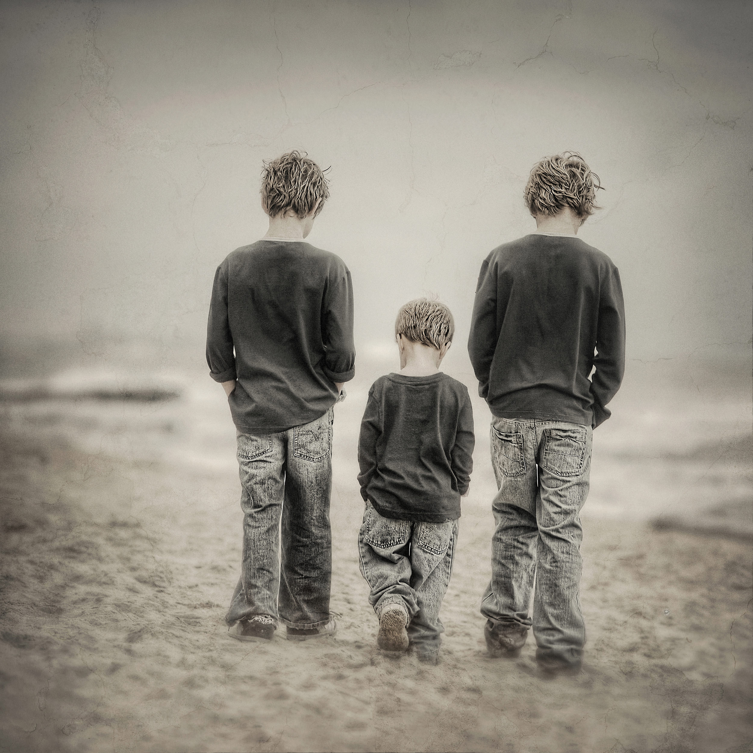 artistic beach portrait of brothers-desaturated colour portrait.jpg