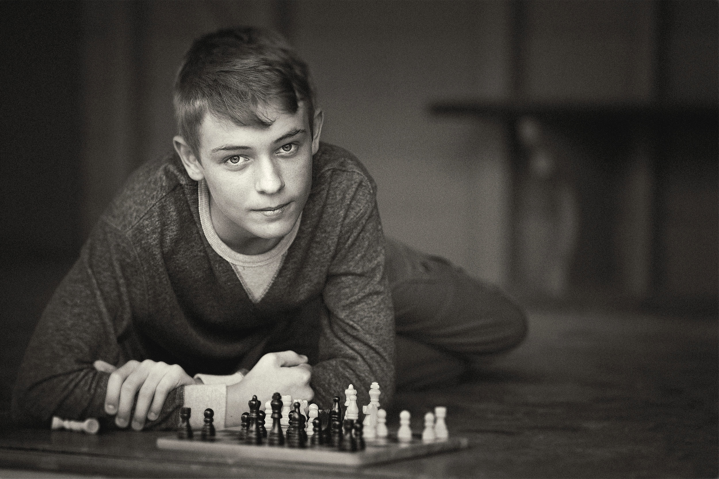 timeless black and white portrait of teenager playing chess-natural light portrait.jpg