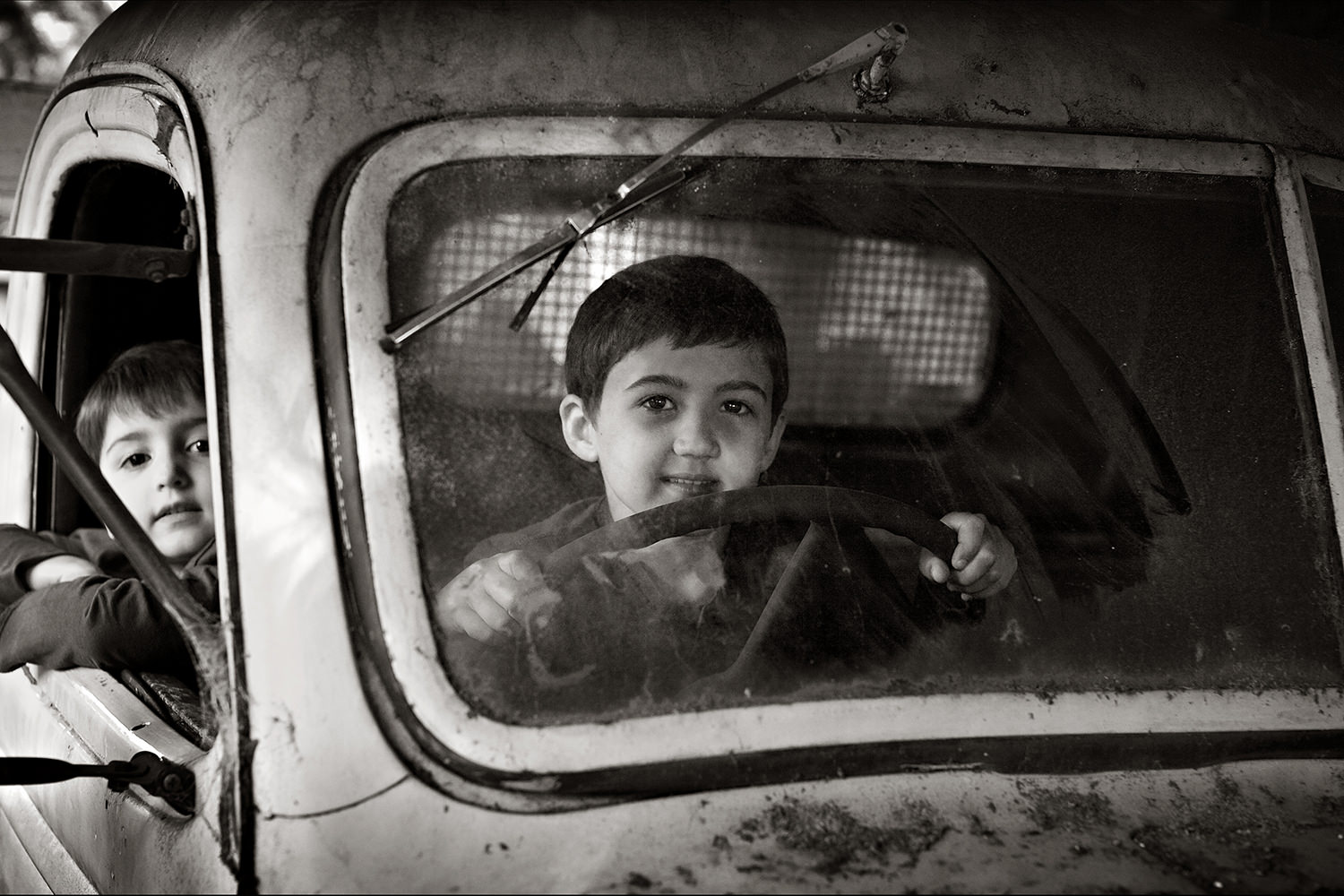 boys in truck-portrait composition-black and white portraits-