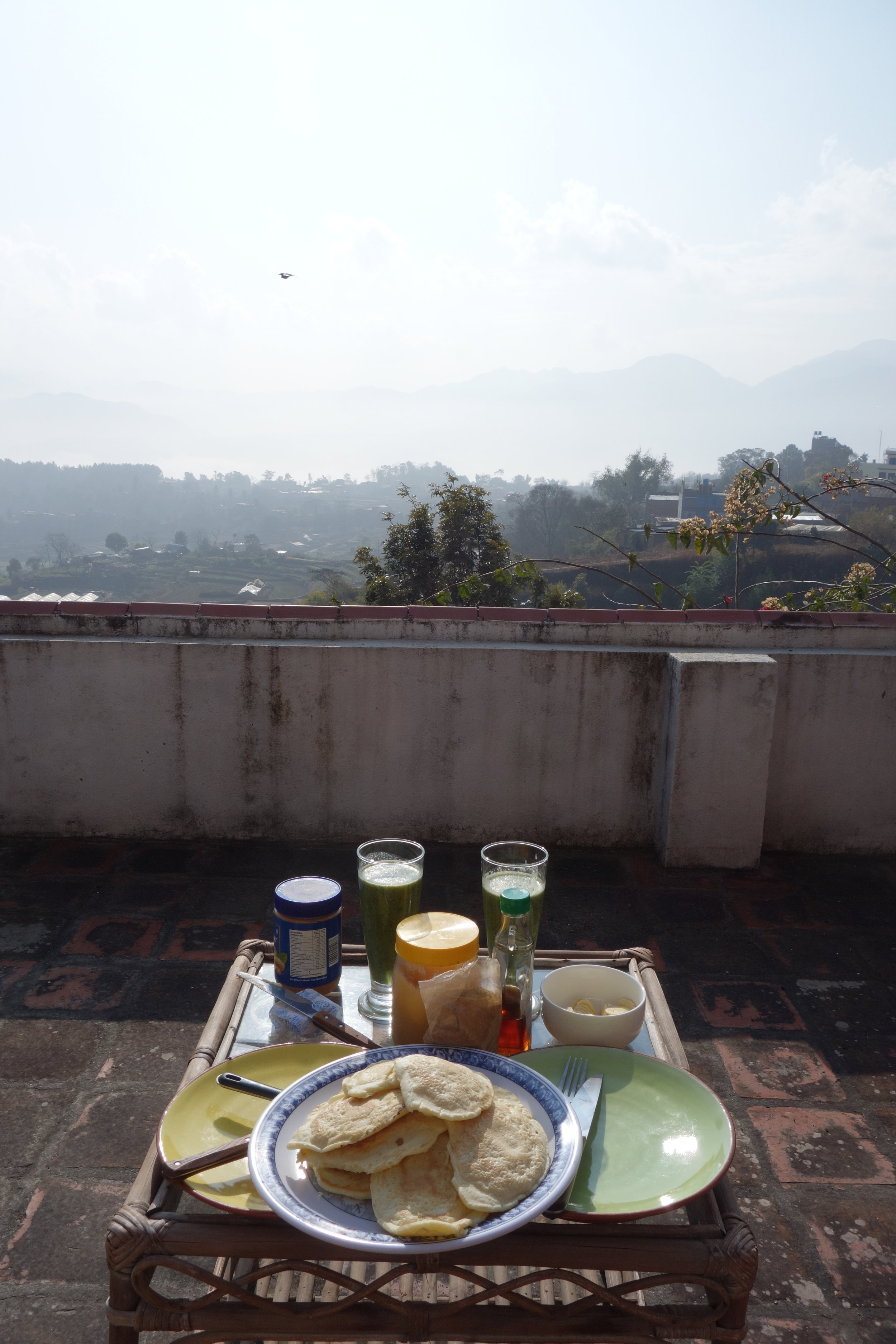 Sunny Sunday morning pancakes and green smoothie on the balcony of my apartment in Pharping