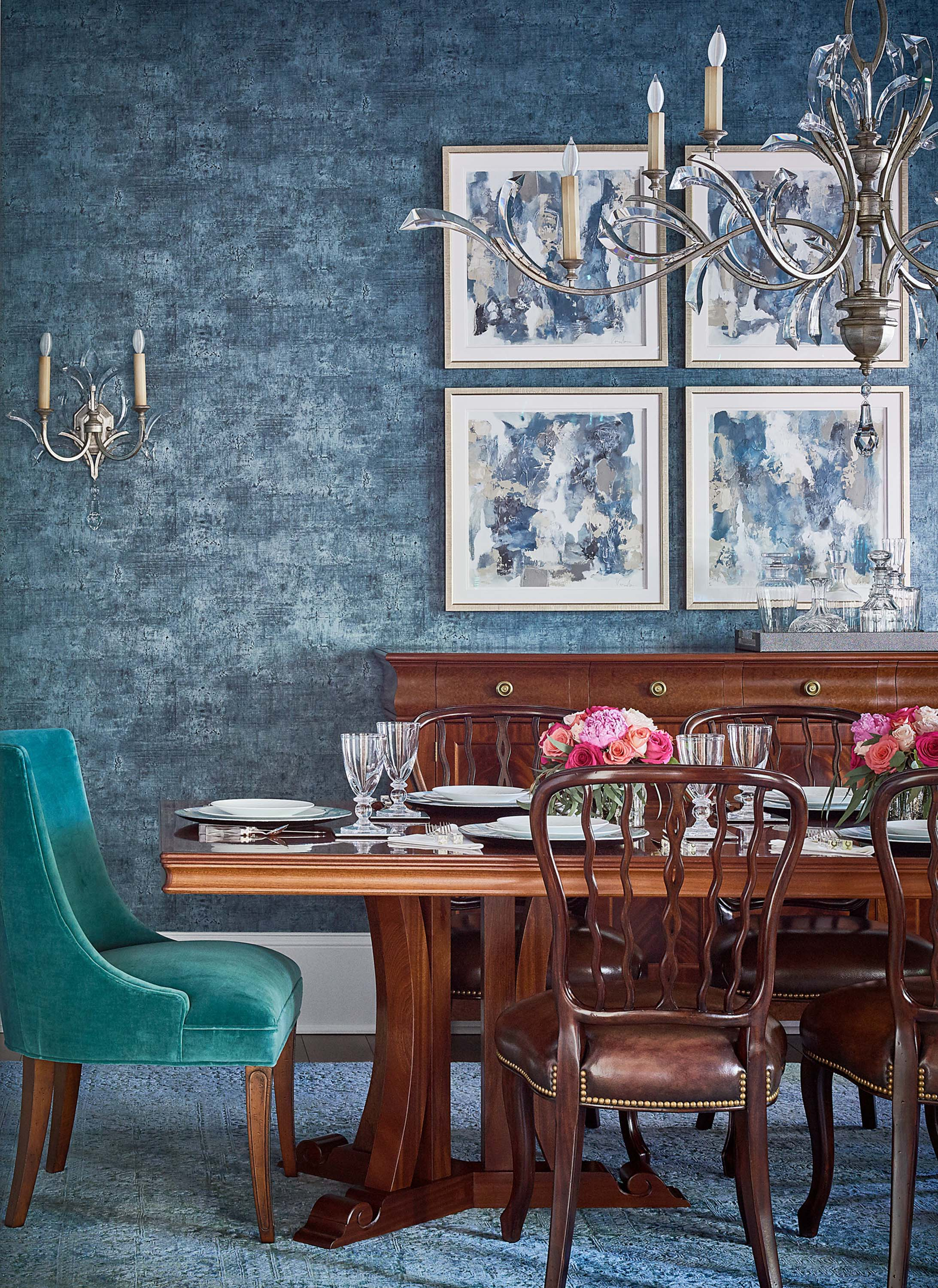 Blue dining room with modern art by Vesela Baker and Fine Arts crystal chandelier and sconces