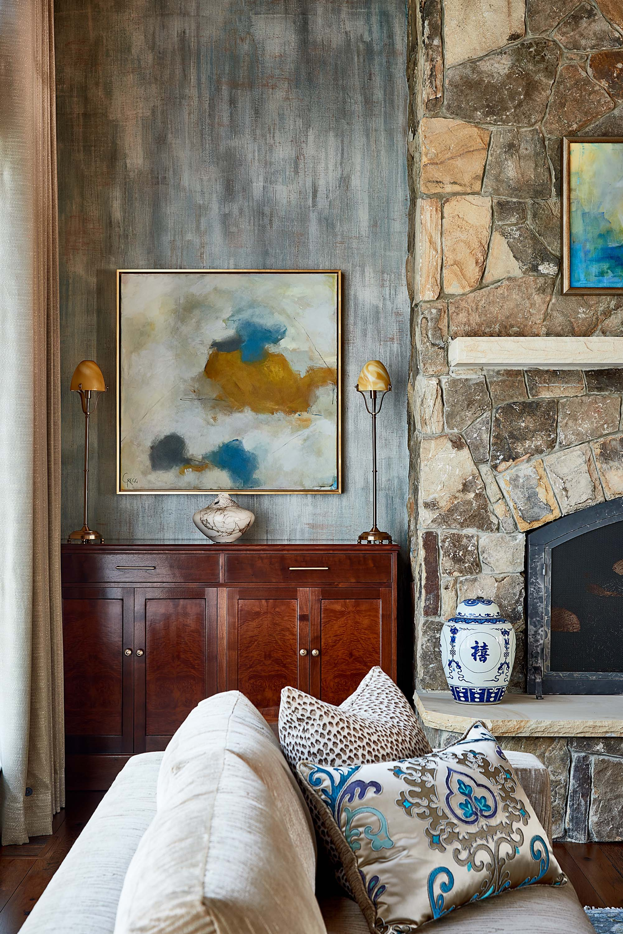 Modern art mixed with traditional interiors in blue and gold