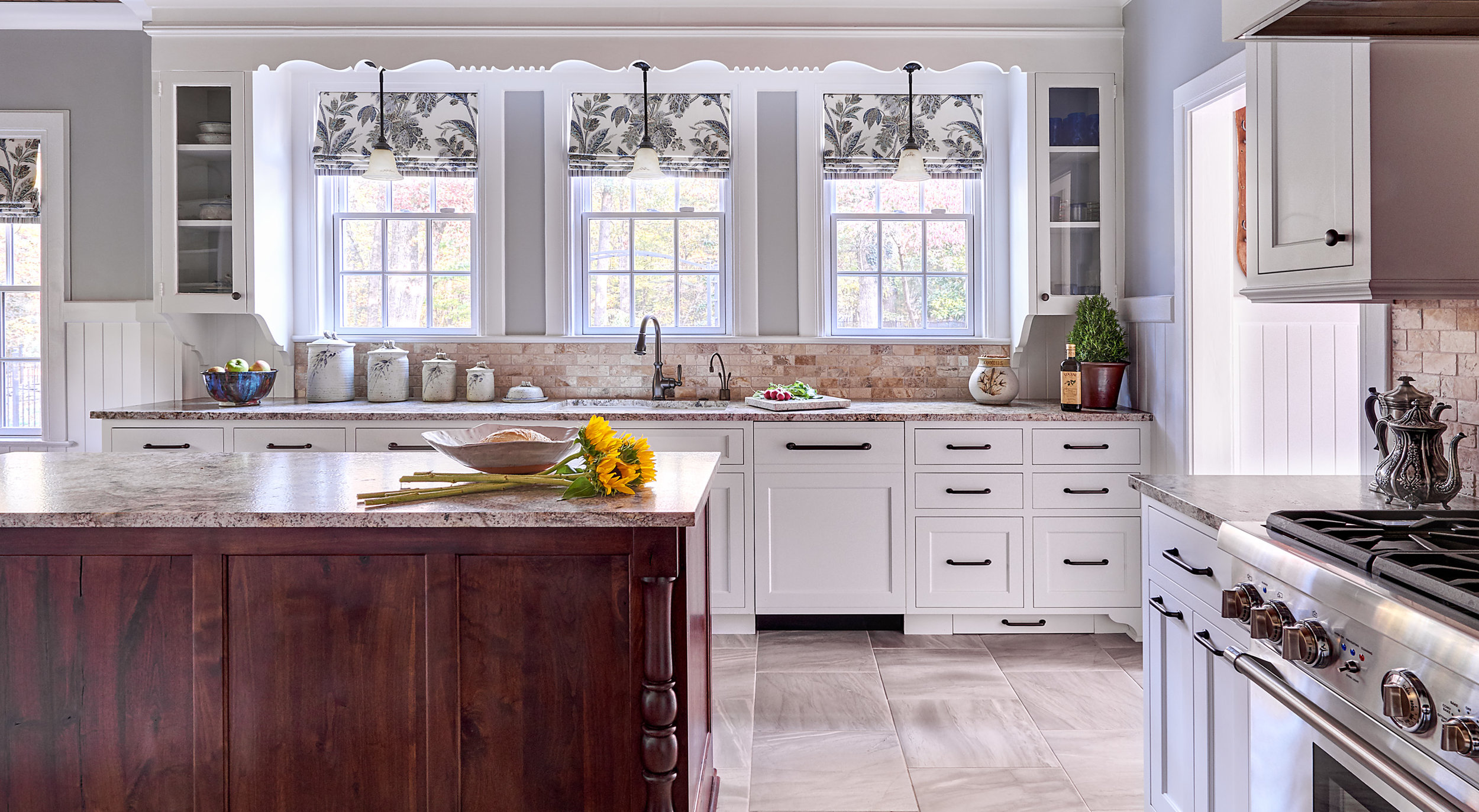 1920's historic home kitchen remodel with white cabinets, scalloped wood valance, roman window shades, tile floor and glass display cabinets