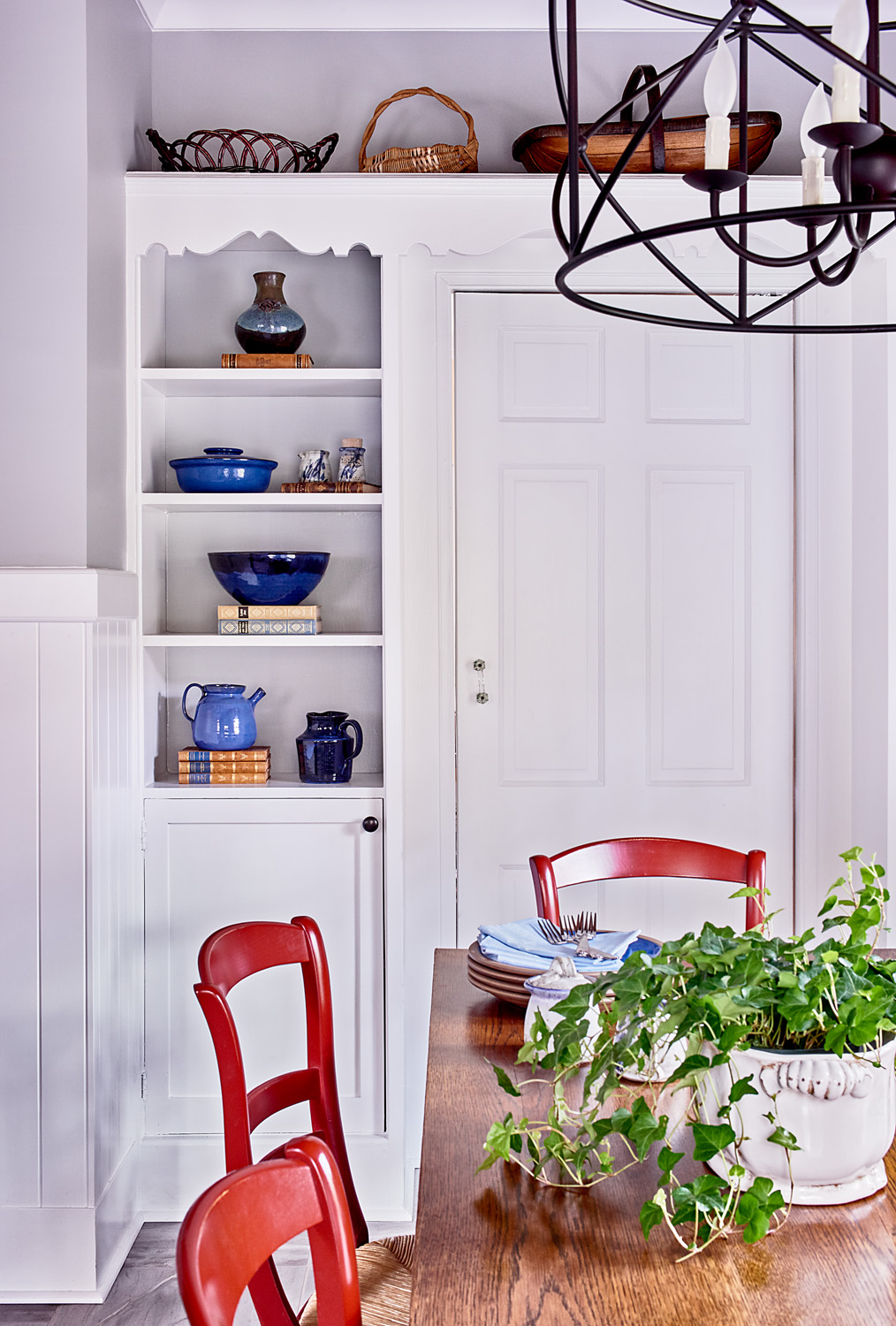 This Old House feature breakfast area with red chairs and built-in cabinets