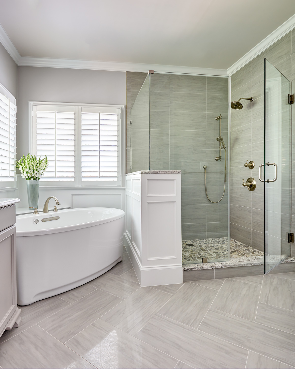 Master bathroom remodel with corner tub and shower with wainscoting