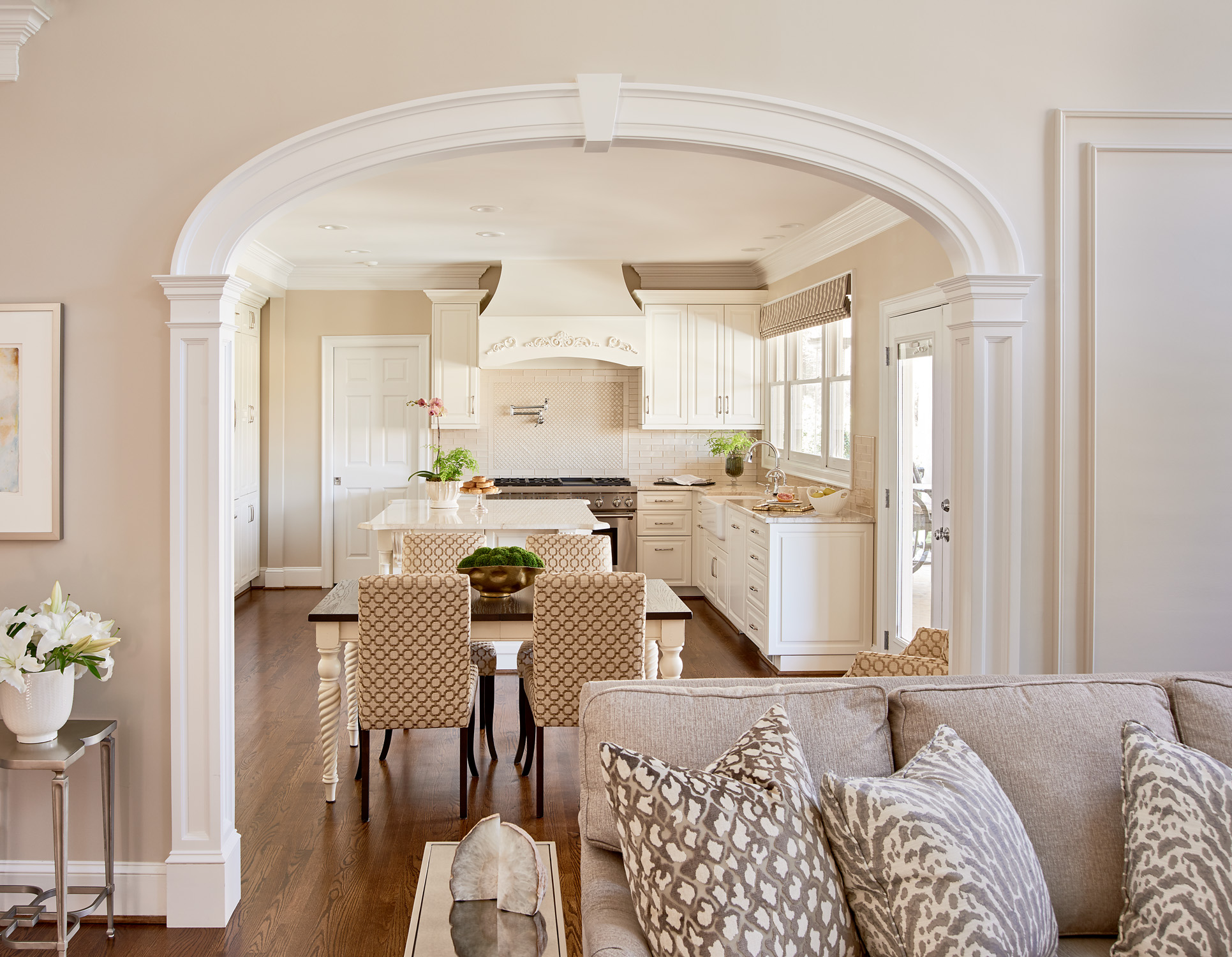 Family room archway looking into transitional kitchen showing architectural details