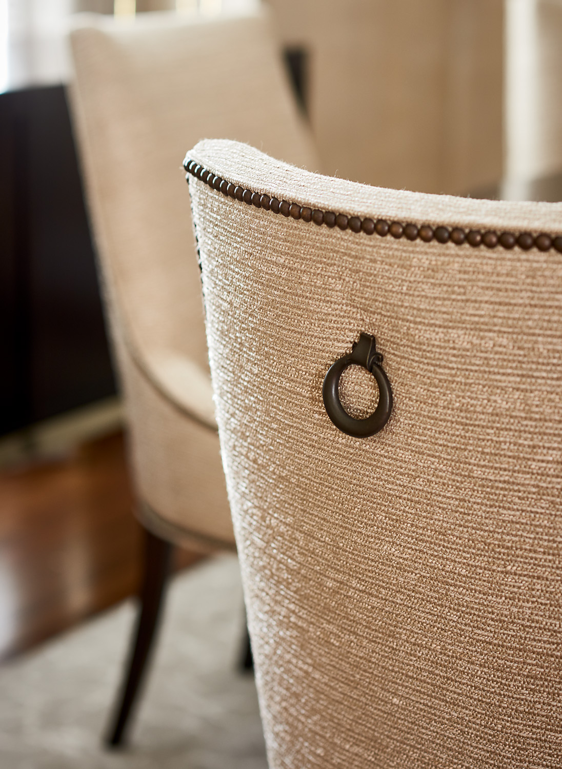 Chair back detail with nailhead and ring