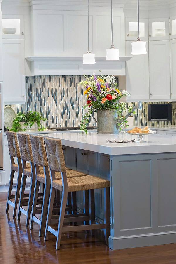 South Charlotte kitchen remodel  with glass tile backsplash gray-blue kitchen island and white cabinets