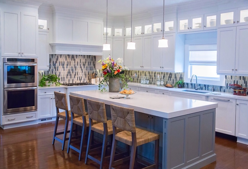 Transitional design kitchen remodel south Charlotte with lighted upper cabinets and glass tile backsplash in blue