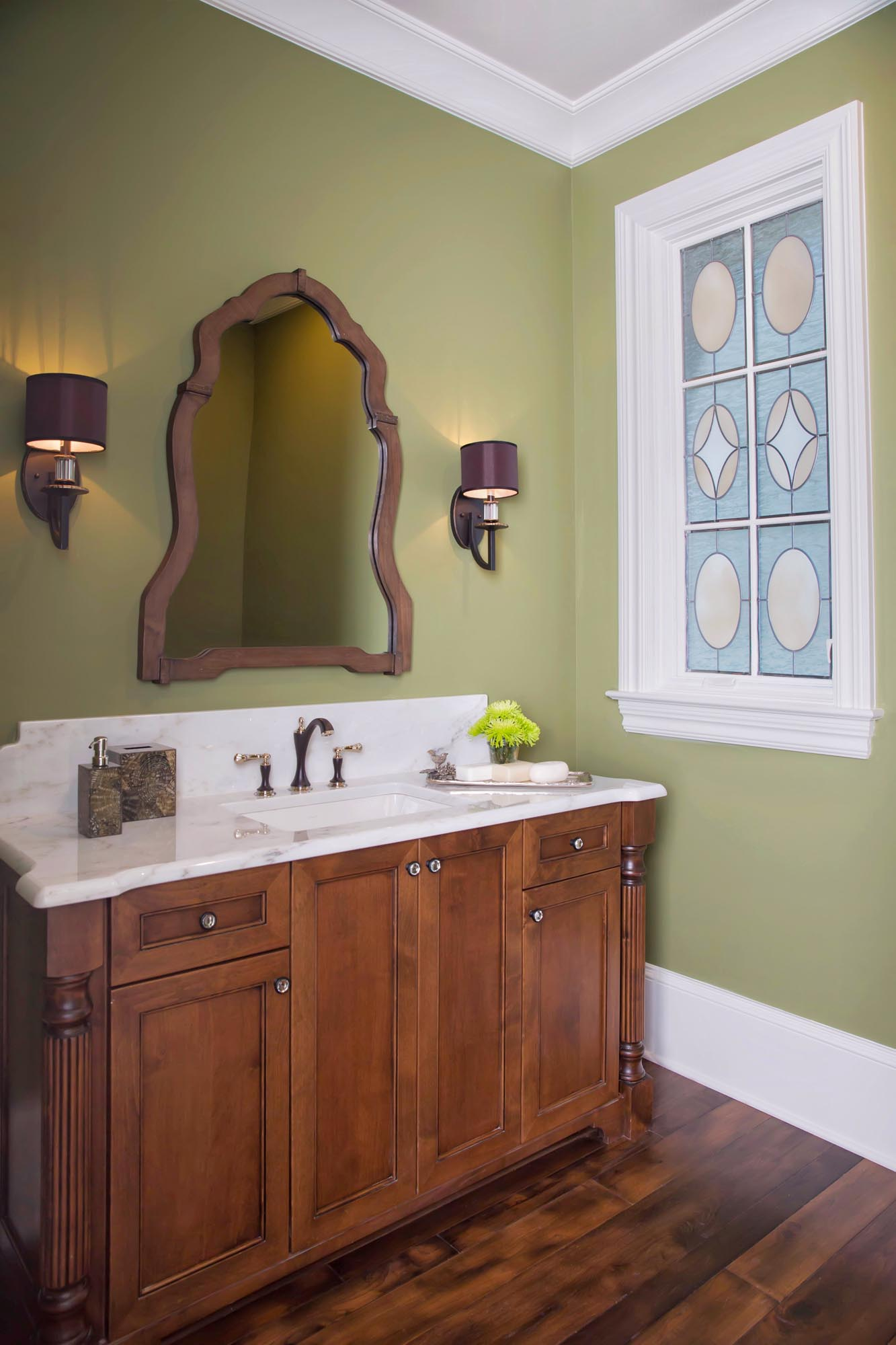 Green walls in powder bath with stained glass window