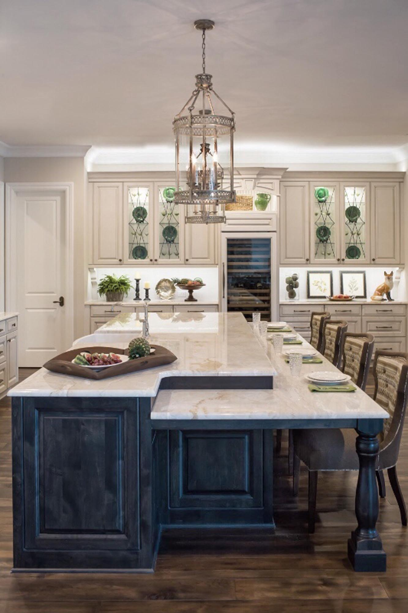Traditional kitchen new construction home cream cabinets with black island wine refrigerator counter chairs