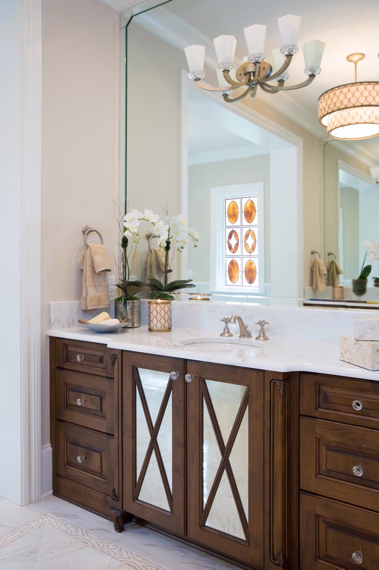 Luxury bath vanity with mirrored door fronts