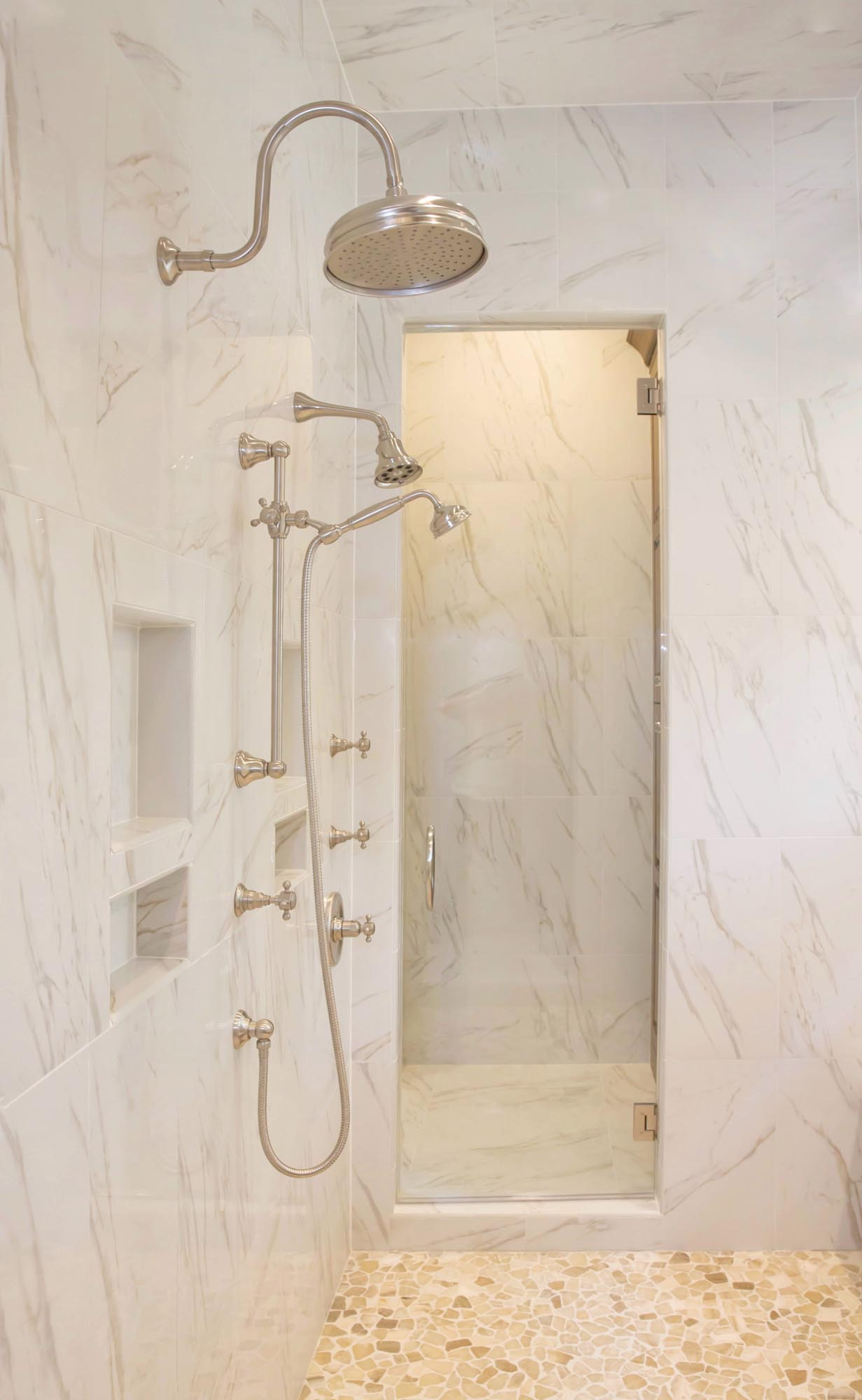 Spa shower in luxury bath with marble patterned tile