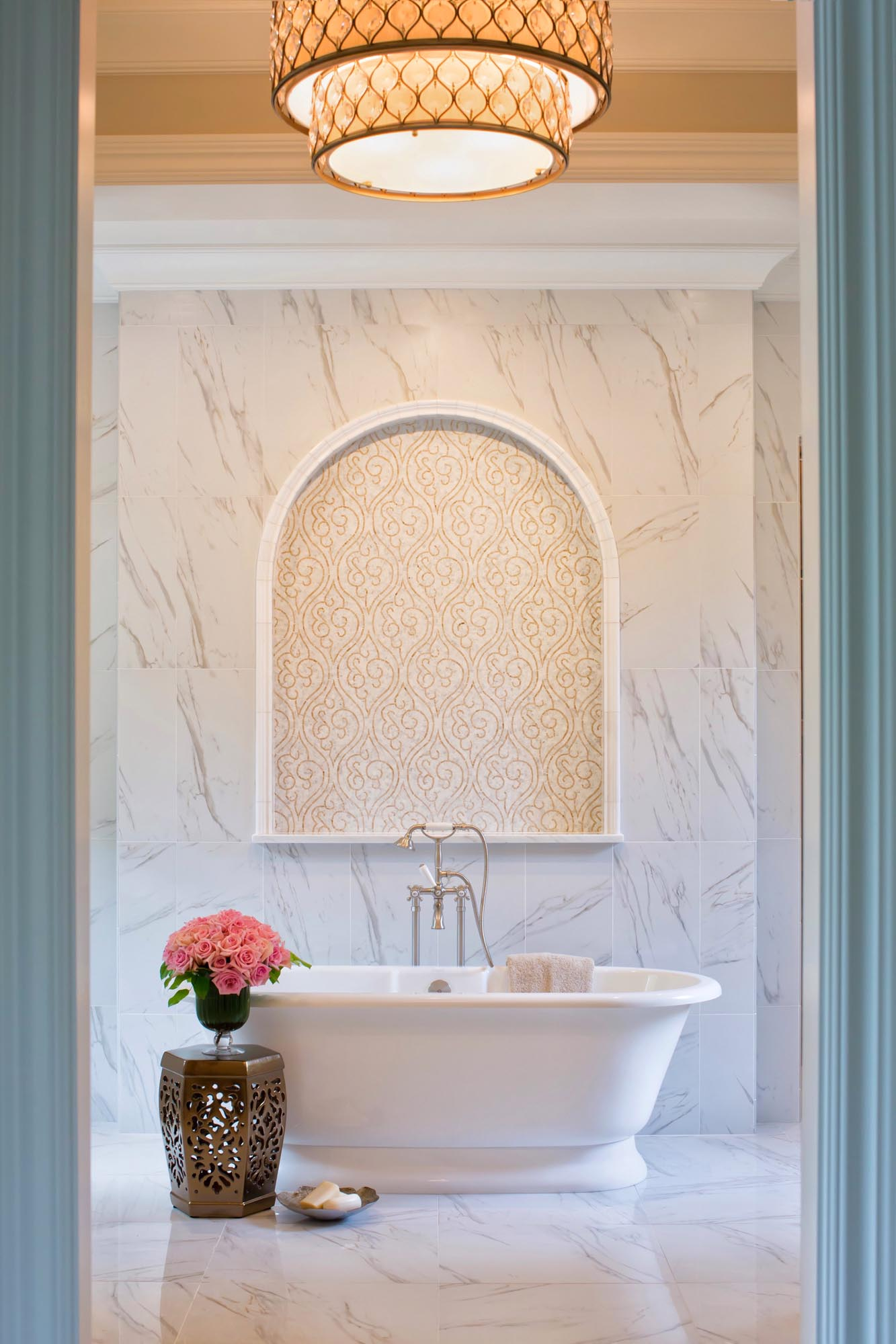 Luxury bath with tiled wall and freestanding tub marble design