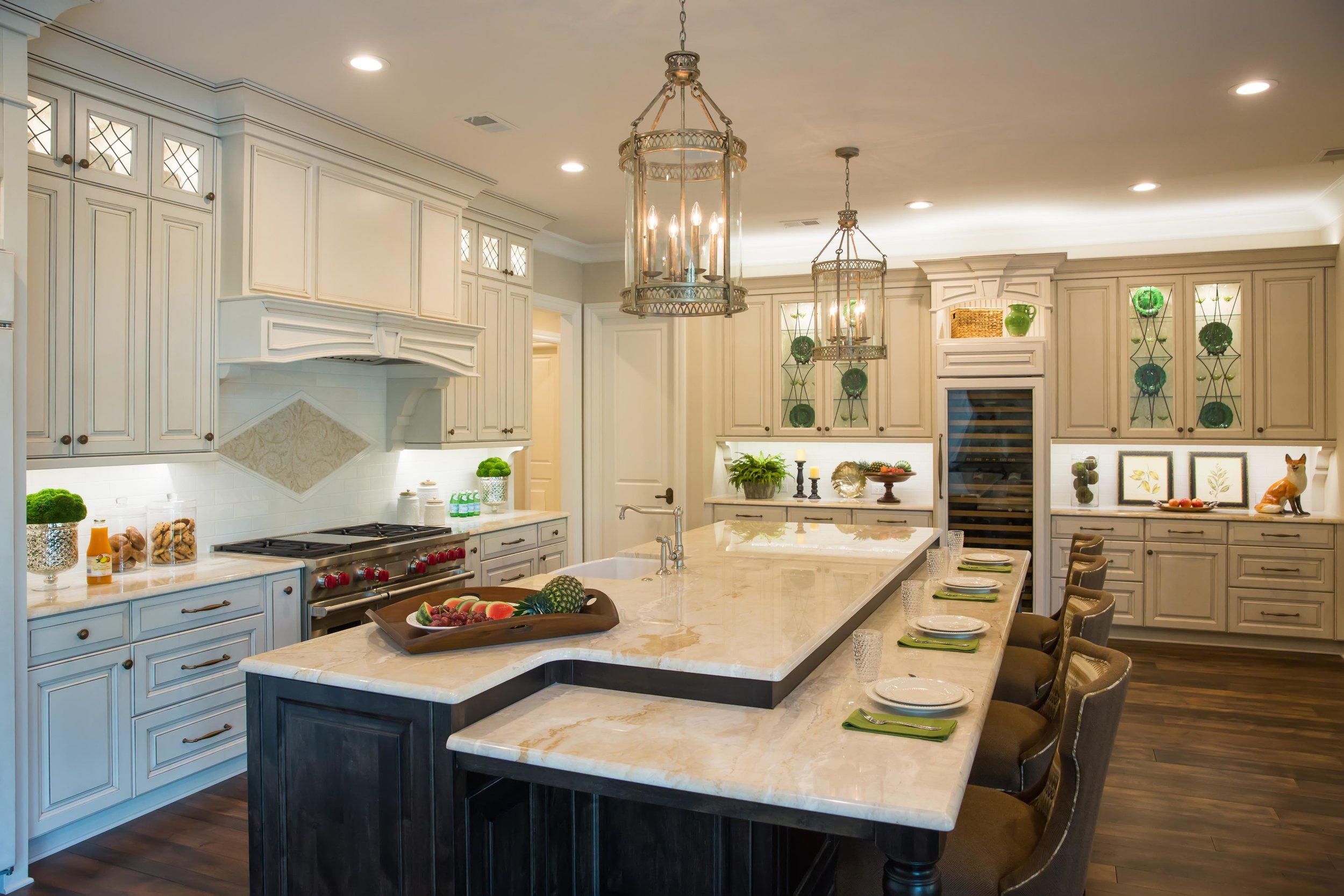 Luxury home kitchen lantern pendants quartzite counters Wolf range wood hood