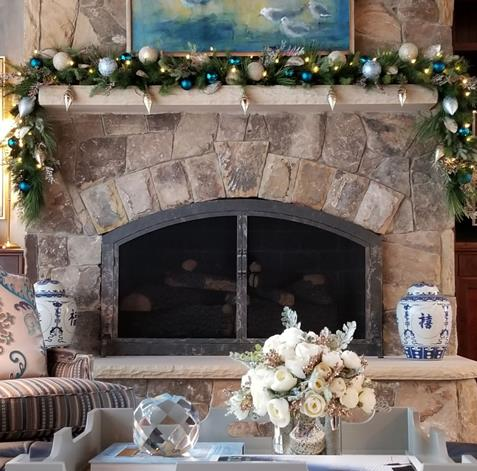 The fireplace in our client's home soars to the ceiling. Look below to see how our photographer, Dustin Peck, captured it in full glory, prior to our decorations. I loved the garland and ornaments nestled in place.