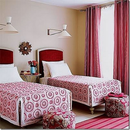 Bedroom with two single beds and red curtain on a large window