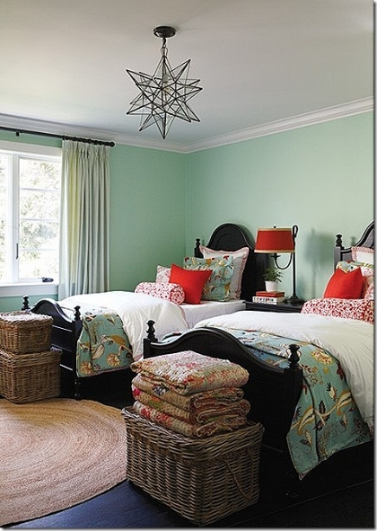 Bedroom with mint green wall and two single beds