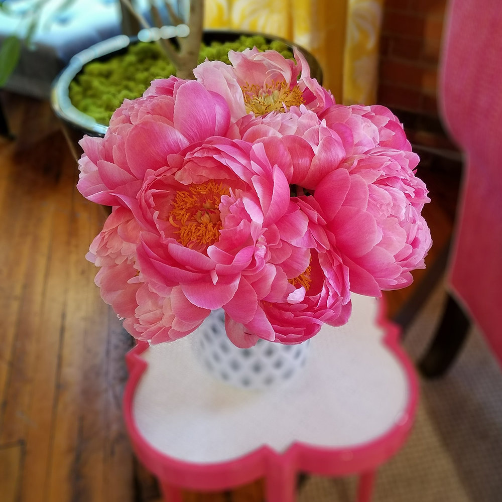 Pink peonies bouquet on a wooden table