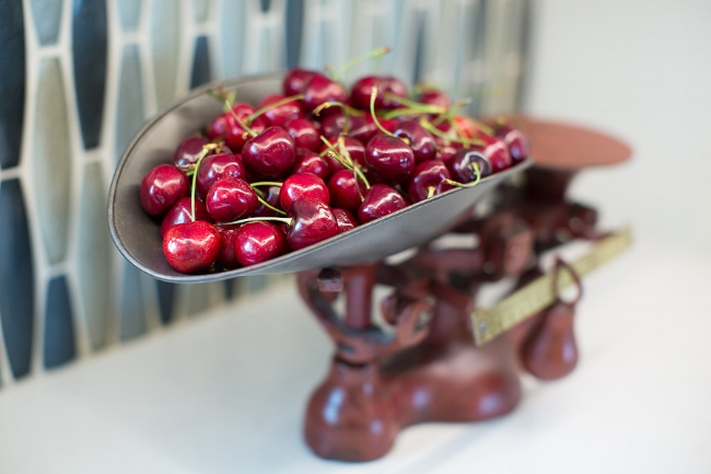 "A different kind of ""Life is a bowl of cherries"". We used my vintage kitchen scale, instead, to contrast the modern tile. Image: Wanda S. Horton Interior Design - Photographer: Whitney Gray"