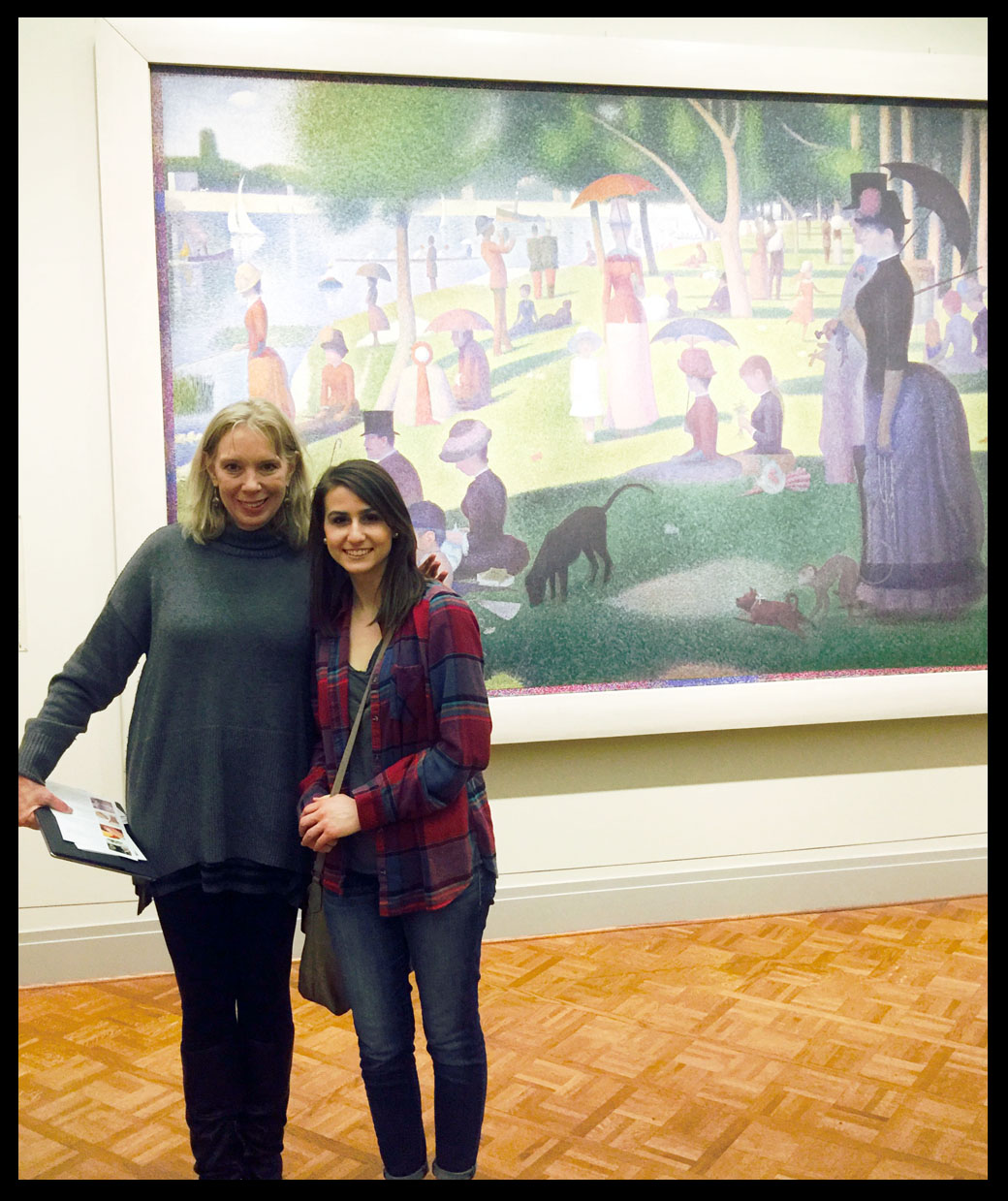 """My niece and I stand in front of """"A Sunday on La Grande Jatte"""" by Georges Seurat, The Art Institute of Chicago."""