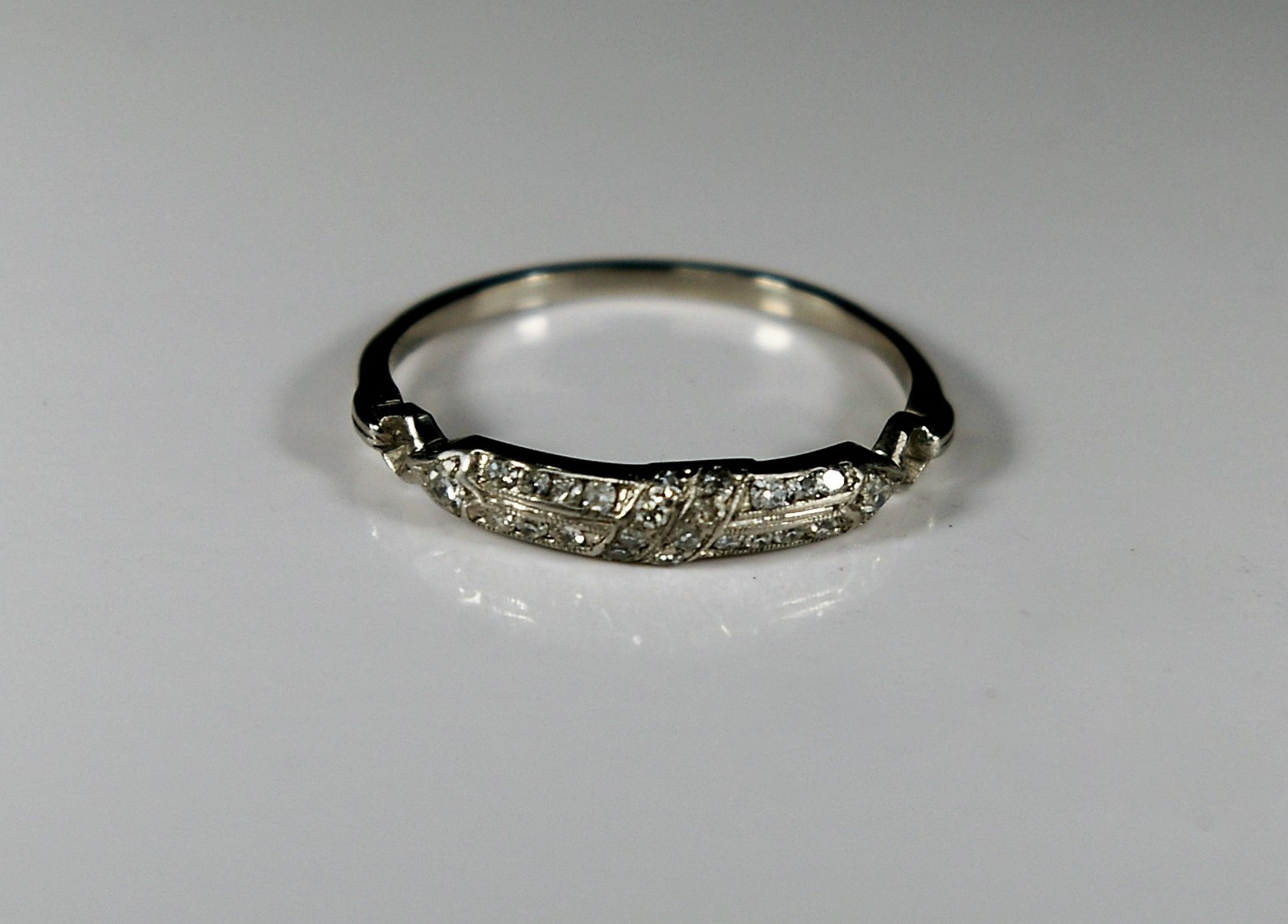 - The wedding ring to the left had been worn almost continuously for two generations. It was being passed on to a third generation. It had been worn next to an engagement ring for nearly a century and was extremely worn and in poor condition.