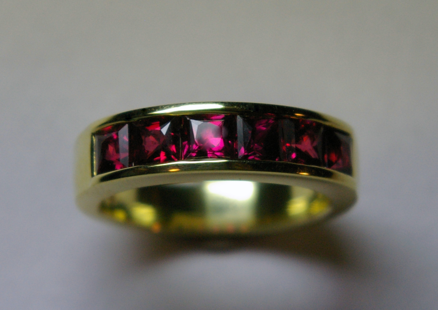 18 Karat Yellow Gold with Square cut Rubies