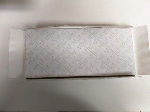 Upside down box with flaps folded back