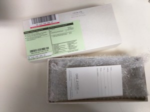 Open box with job envelope and bubble wrap