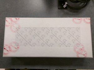 Box with red round date stamps