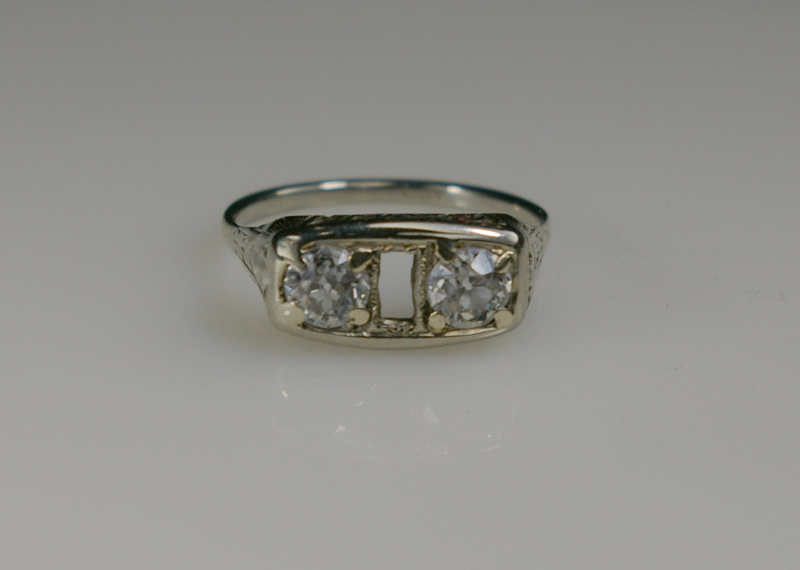 A platinum ring missing the center stone before restoration
