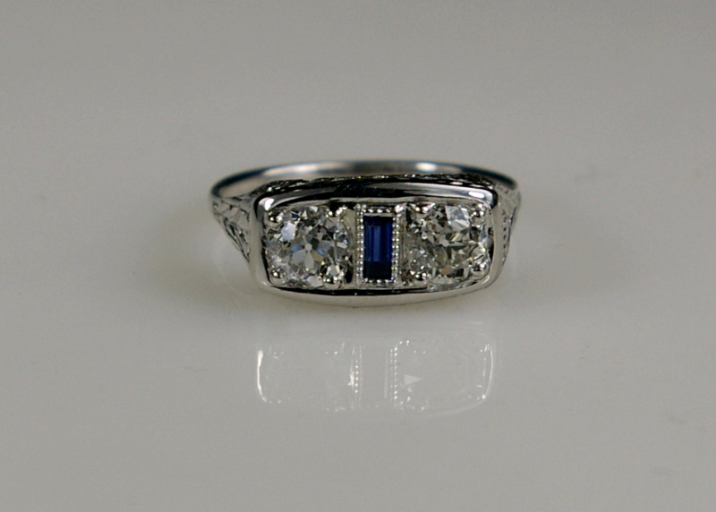 The same ring after restoration with a fine sapphire baguette set in the center