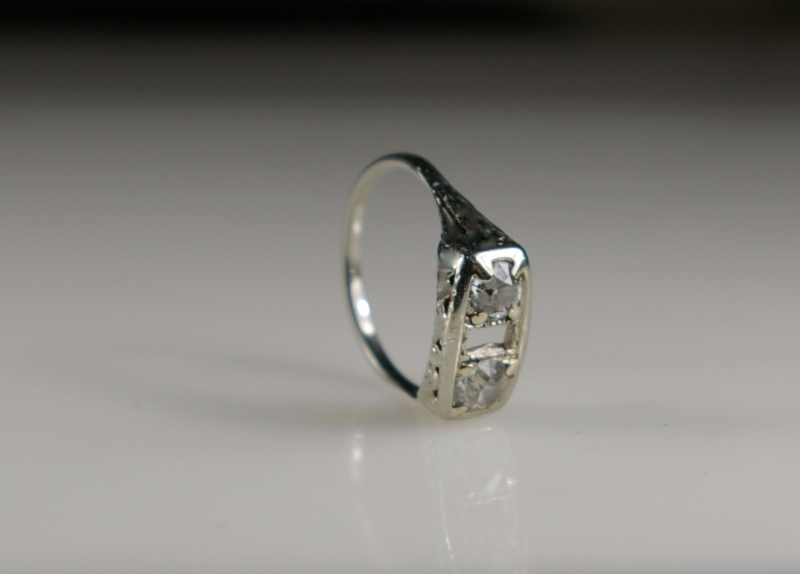 a-platinum-ring-missing-the-center-stone-before-restoration-the-side-view-at-crane-jewelers-ltd-in-seattle-wa.jpg