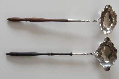18th Century Ladles - Two double lipped punch ladles, the one with the lighter handle London 1746, by David Henell, the other possibly American by William Homes