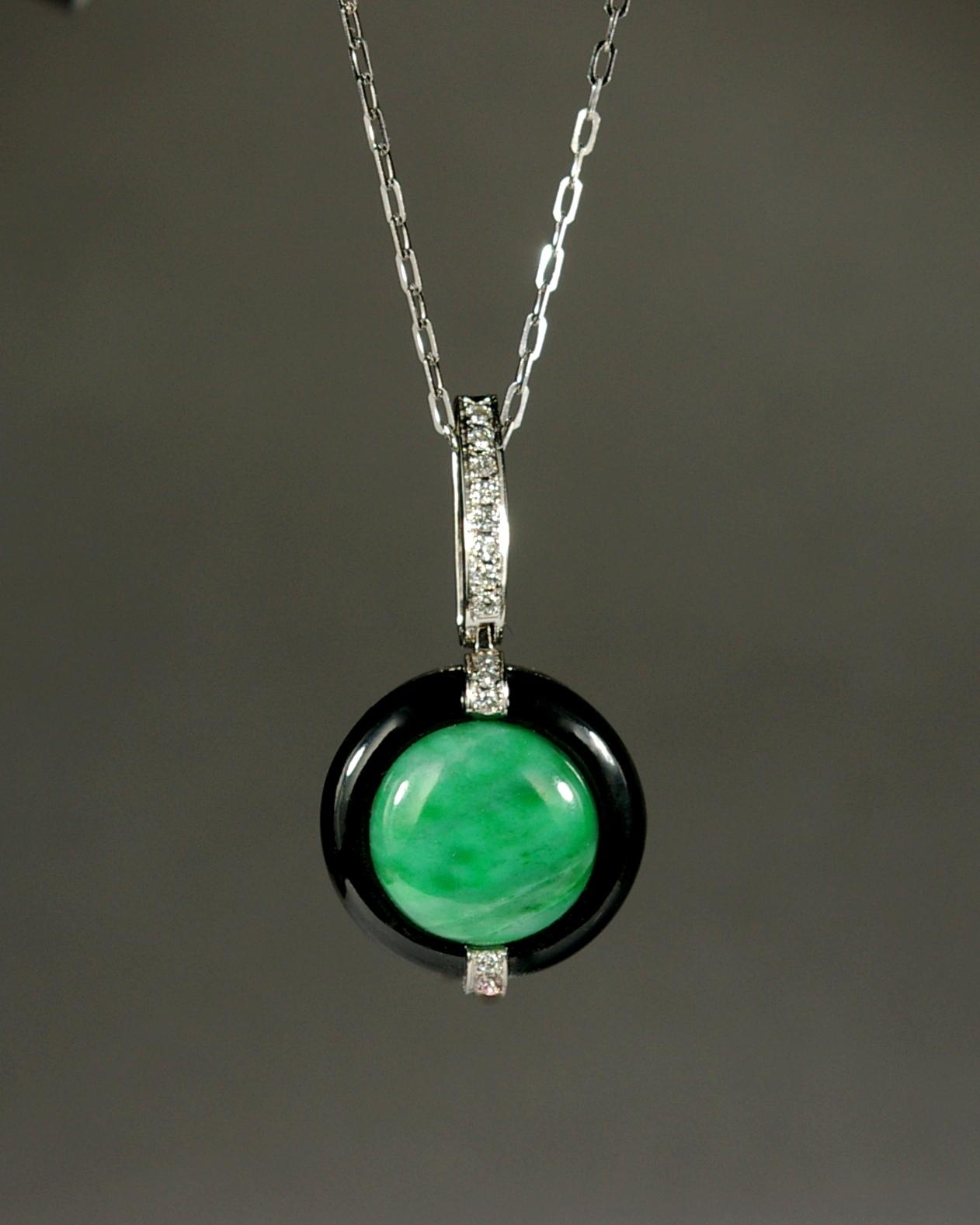 14 Karat White gold with brilliant cut diamonds. custom design green and black jade