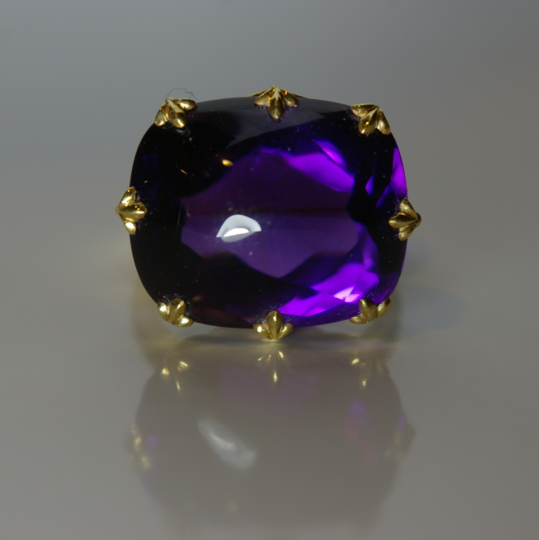 Amethyst ring with 18 Karat Yellow Gold. Center stone 24.65 carats