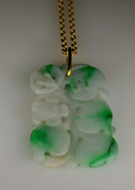 Moss and Snow carved Jade with 20 Karat Yellow Gold bail