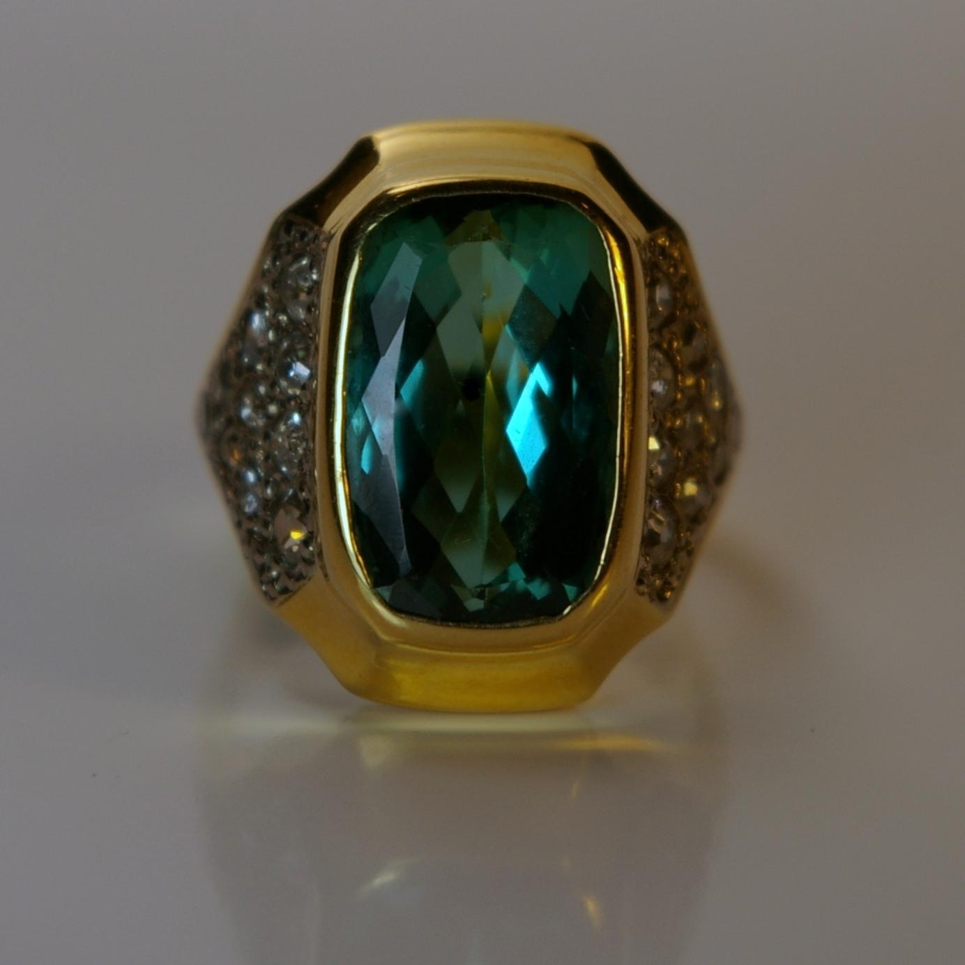 18 Karat Yellow Gold with diamonds .80 carats total weight. Center stone Tourmaline 6.35 carats