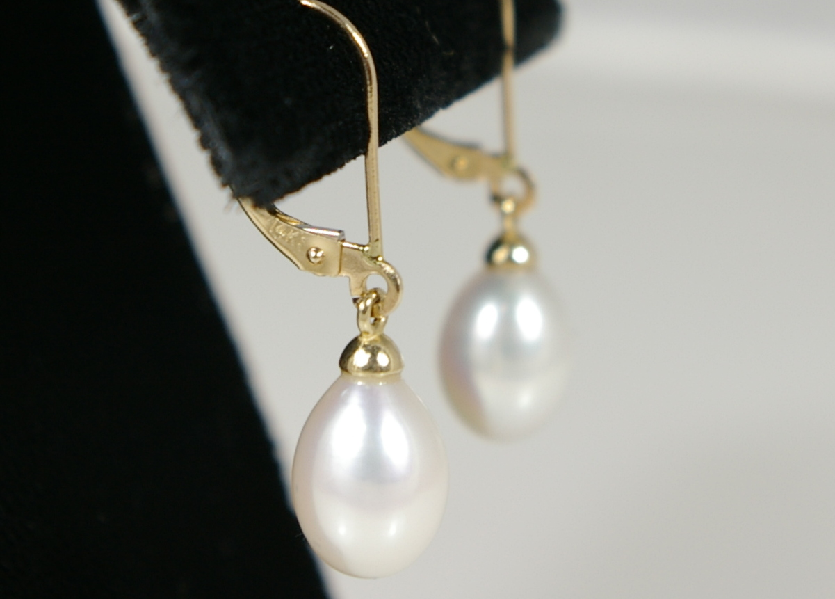 Fresh water cultured pearls with 14 Karat Yellow Gold