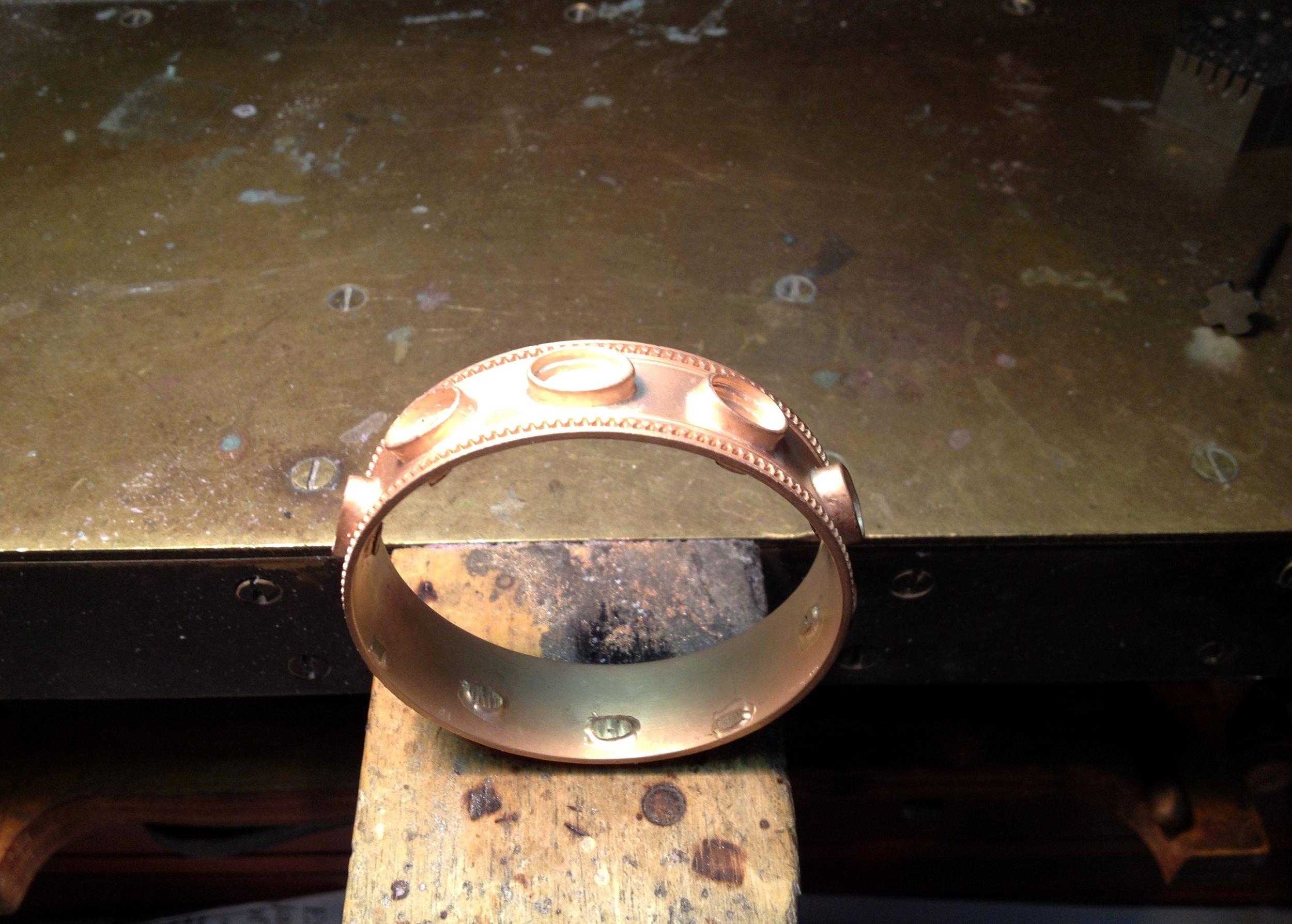 22-karat-gold-custom-designed-Etruscan-bracelet-after-casting-on-the-bench.jpg