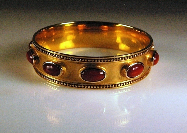Finished Piece polished and set with Oxblood Coral