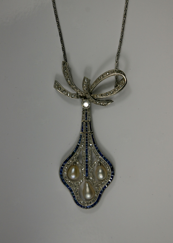 An antique necklace for Restoration  made of White gold and platinum pendant set with pearls, sapphires and diamonds, Crane Jewelers Ltd. 519 Pine Street Seattle WA 09101.JPG