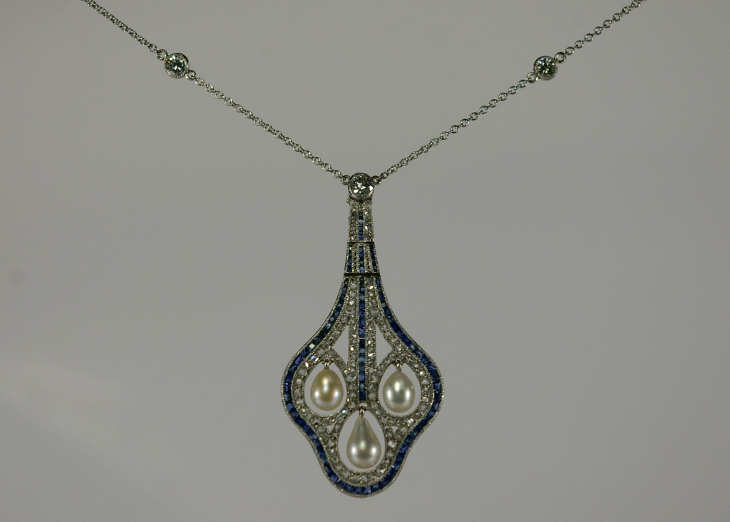 Completed Restoration on a antique platinum pendant set with pearls, sapphires and diamonds restoration by Crane Jewelers Ltd. 519 Pine Street Seattle WA 09101.JPG