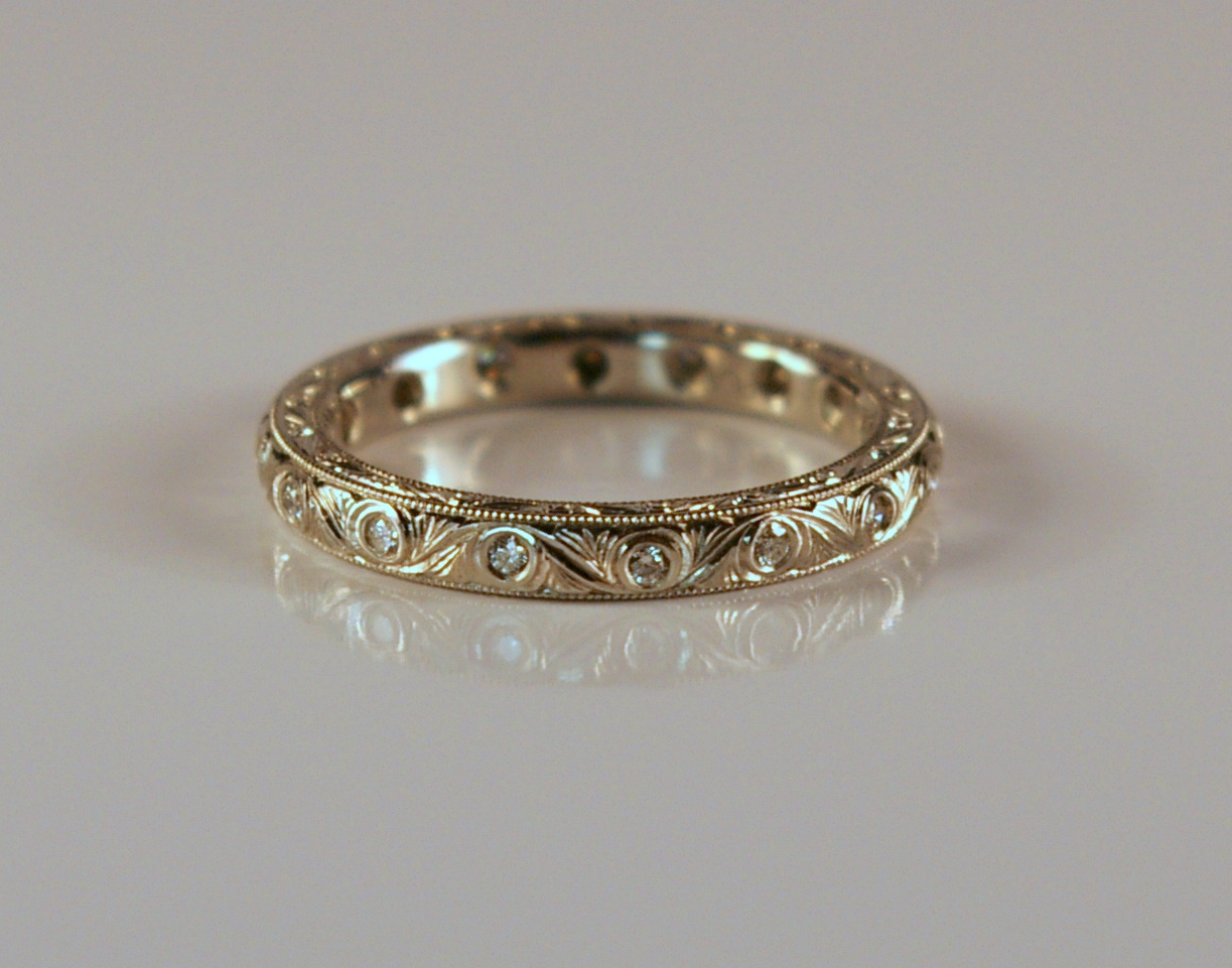 Hand Carved and Engraved Platinum ring with Diamonds